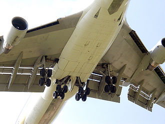 LAPA Flight 3142 - The flaps on this Boeing 747 are the surfaces that extend behind the wings, thus permitting the airplane to maintain sufficient lift to fly at lower speeds, during takeoff, initial ascent, approach, and landing.