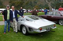 Valentino Balboni, Mike Gulett and a silver Bizzarrini GT 5300 Strada in Monterey.jpg
