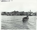 View looking south towards Circular Quay showing ferries and wharves, Sydney (NSW) (7701488704).jpg