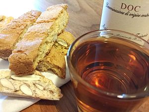 Vin Santo - A glass of Vin Santo with its characteristic amber colour and biscotti