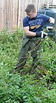 Volunteers help clear garden for local disabled homeowner 120825-F-UA873-437.jpg