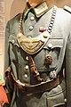 """WW2 German army military police Feldgendarmerie tunic, gorget, DRL sport badge (Deutsches Reichssportabzeichen), badge-patch of SS membership, Sam Browne crossbelt, etc. Lofoten Krigsminnemuseum (""""Gestapo office"""") 2019-05-08 DSC00192.jpg"""