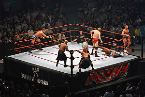 Tag team - Action in a triple threat tag team match for the WWE World Tag Team Championship. Shelton Benjamin (on the mat) from The World's Greatest Tag Team has been isolated in the corner of champions Cade and Murdoch, well away from partner Charlie Haas; either of these teams can tag in the third team, The Highlanders.