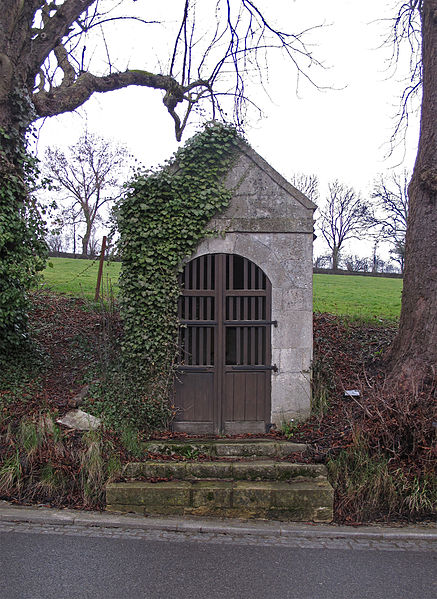 Wayside chapel with wayside cross inside in Sprinkange, Luxembourg, rue du Moulin