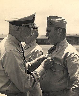 William W. Rogers - Colonel Wiliam W. Rogers, USMC being decorated with the Legion of Merit by Admiral Chester Nimitz