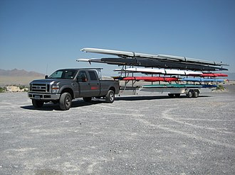 Glossary of rowing terms - 41 foot aluminium trailer with various types of rowing boats