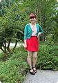 Woman in a red miniskirt and green cardigan.jpg