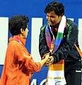 XIX Commonwealth Games-2010 Delhi The Union Minister for Tourism & Housing and Urban Poverty Alleviation, Kum. Selja congratulates Ranu Bala Chanu Yumnam of India.jpg