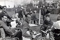 Australian Paralympic Team members in the in-field at the athletics during the 1964 Tokyo Paralympic Games. From left (seated) Frank Ponta, team official John Johnston, Elizabeth Edmondson, unknown and Bill Mather-Brown