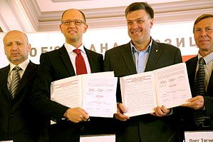 Oleksandr Turchynov - Turchynov, Arseniy Yatsenyuk and Oleh Tyahnybok with coalition agreement before 2012 Ukrainian parliamentary election.