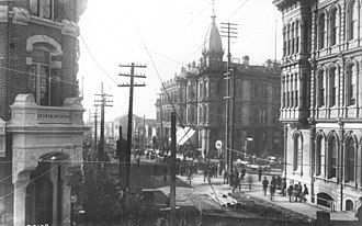 Great Seattle Fire - Looking west on Mill Street (today's Yesler Way) across Front Street (today's First Avenue) June 5, 1889, one day before this district burned. Korn block on left; Yesler-Leary Building, center; Occidental Hotel, right.