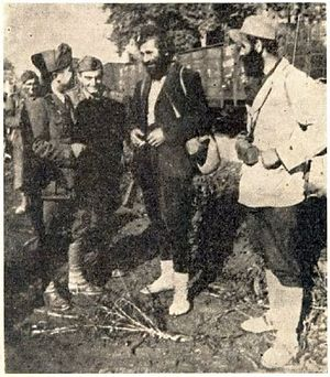 Case White - Chetniks with Italians, waiting to be transported by train.