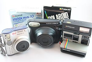Instant camera - One Polaroid and two Fujifilm instant cameras with film