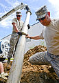 116th Civil Engineering Squadron repair drainage problem 130413-Z-XI378-011.jpg