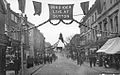 1745. High Street Sutton. Xmas Show Week 1910. S&W Series.jpg
