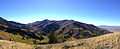2014-10-04 15 55 03 Panorama southwest toward Whitebark Pines, Aspens during autumn leaf coloration, Coon Creek Summit and the Copper Mountains from the road to Deer Mountain southwest of Jarbidge, Nevada.JPG