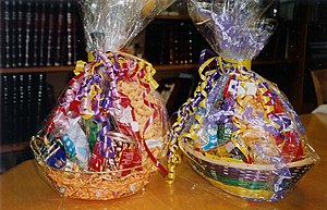Mishloach manot - Gaily wrapped baskets of sweets, drinks and other foodstuffs given as mishloach manot on Purim day.
