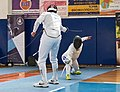2nd Leonidas Pirgos Fencing Tournament. The fencer on the right is about to score a foot touch.jpg
