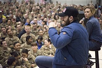 Chris Evans (actor) - Evans and Scarlett Johansson at a USO tour event in December 2016.