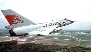 K. I. Sawyer Air Force Base - F-106A (59-0094) of the 87th Fighter-Interceptor Squadron in flight in the early 1980s. Note the Tactical Air Command emblem on the tail, replacing the squadron emblem.