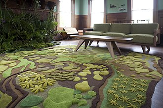 Angela Adams - Forest Floor Treasure tapestry, Munjoy Sofa, Munjoy Coffee Table