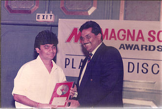 A. R. Rahman - Rahman (left) receiving a platinum award at the MagnaSound Awards; MagnaSound released his first film soundtrack, Roja, in 1992.