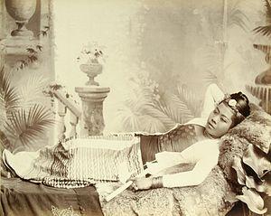 Cheroot - A Burmese Girl Holding a Cheroot, Watts and Skeen, Burma Albumen print1890