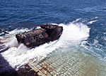 A U.S. Marine Corps assault amphibious vehicle leaves the well deck of the amphibious dock landing ship USS Tortuga (LSD 46) in preparation for a joint amphibious assault exercise with the Royal Thai Navy as 130609-N-IY633-079.jpg
