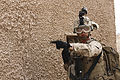 A U.S. Marine with the 3rd Battalion, 6th Marine Regiment, 2nd Marine Division signals to another squad during a raid in support of Weapons and Tactics Instructor Course 2-14 in Yuma, Ariz., April 9, 2014 140409-M-HY842-027.jpg
