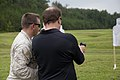 A business leader attending a Marine Corps Executive Forum (MCEF) fires an M9 Beretta pistol at a target under the supervision of a U.S. Marine aboard Marine Corps Base Quantico, Va., July 11, 2013 130711-M-MI461-354.jpg