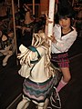 A girl at a merry-go-round, Pleasure Land, Yokohama, Japan; May 2011.jpg
