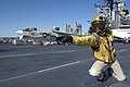 A mannequin depict a Sailor launching an aircraft on the flight deck of the USS Midway Museum.jpg