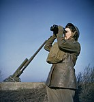 A member of the ATS (Auxiliary Territorial Service) serving with a 3.7-inch anti-aircraft gun battery, December 1942. TR455.jpg