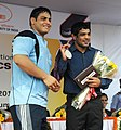 """A young sports person of """"Come & Play Scheme"""" of Sports Authority of India, after presenting the cheque of Special Cash Award to Shri Sushil Kumar, the Medal winner of London Olympics 2012, at the felicitation function.jpg"""