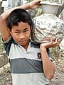 Adivasi (Indigenous) Boy Carrying Water Jug - Chittagong Hill Tracts - Bangladesh (13185292733).jpg