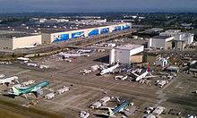Boeing's factory in Everett, Washington in 2011. The planes are on tarmac outside warehouse-like buildings