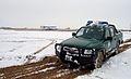 Afghan police women drive through an empty field (6480099841).jpg