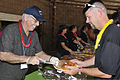 Alan McAlister, left, senior pastor with the Central Baptist Church, serves food to a U.S. Airman during Cannon Appreciation Day at Cannon Air Force Base, N.M., Aug. 10, 2012 120810-F-AX764-022.jpg