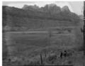 Albert E. Jones property, east of Virgin River, south of park boundary, three men standing near the fence. ; ZION Museum and (2a26027519e94befa44398fd002e2c26).tif