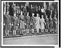 American Women's Voluntary Services members posed on steps, wearing various AWVS uniforms 3c11174v.jpg