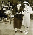 American soldier seeking assistance from volunteer teacher while making purse, WWII (34756210745).jpg