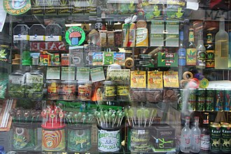 Cannabis consumption - Various types of cannabis foods on display in a shop window in Amsterdam