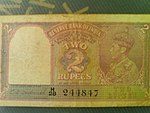 An old two rupee note with King George VI on it.jpg