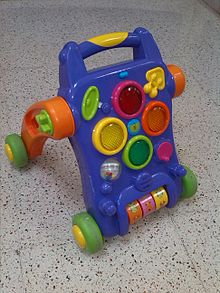 A toy with four wheels and a handle at the top