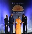Atmaprajnananda receive awards from Jackie Shroff.jpg