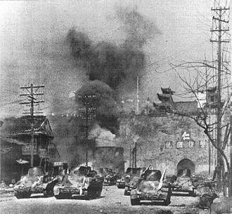 Type 94 tankette - The moment of the blast, at the Gate of China (December 12, 1937).