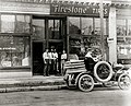 "Automobile tire repair truck outside H. Bender Firestone Tire dealership. 4388 Olive Street. ""Vulcanizing and Repairing All Makes of Tires."".jpg"