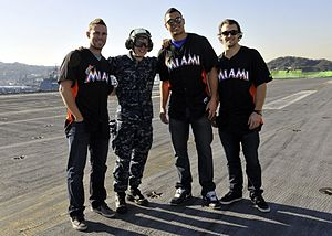 Aviation Boatswain's Mate Equipment Airman Michael Shores pauses to take a quick photo with players of the Florida Marlins after giving them a tour of the flight deck catapult systems aboard the USS George Washington (CVN 73).jpg