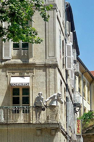 Statues gaze over the Place de l'Horloge in the town centre Avignon statues.jpg