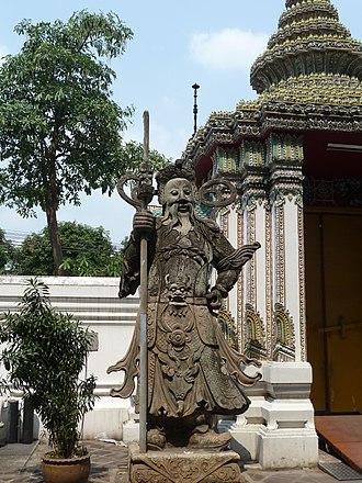 Wat Pho - Chinese guardian figure beside a gate in Wat Pho